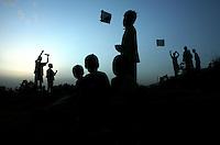 Boys fly kites in an empty lot in Kathmandu on June 14, 2006. (Photo/Scott Dalton)