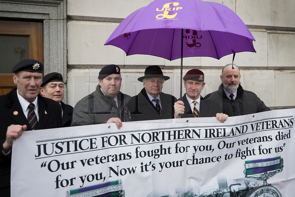 © Licensed to London News Pictures. 03/02/2018. London, UK. UKIP Leader Henry Bolton (2R) wearing the beret of The Royal Hussars, his former British Army regiment, takes part in a Veterans for Justice March in central London .Photo credit: Peter Macdiarmid/LNP