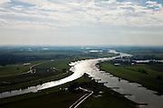 Nederland, Gelderland, Gemeente Arnhem, 03-10-2010; IJsselkop, splitsing van de Rijn (= Pannerdensch kanaal) in Gelderse IJssel (naar links) en Nederrijn. Links de uiterwaarden van de Hondschbroeksche (Hondsbroekse Hondsbroekse) Pleij, met hoogwatergeul en regelwerk. Rechts de Huissense (Huissensche) Waarden.Head of river IJssel, division of Rhine in Lower Rhine (to the right) .and Guelders IJssel..luchtfoto (toeslag), aerial photo (additional fee required).foto/photo Siebe Swart