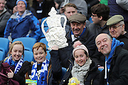 football fans, football supporters wint tin foil FA Cup during the The FA Cup match between Brighton and Hove Albion and Milton Keynes Dons at the American Express Community Stadium, Brighton and Hove, England on 7 January 2017.
