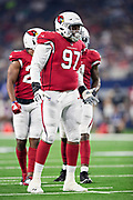 ARLINGTON, TX - AUGUST 26:  Owen Obasuyi #97 of the Arizona Cardinals at the line of scrimmage during a game against the Dallas Cowboys at AT&T Stadium during week 3 of the preseason on August 26, 2018 in Arlington, Texas.  The Cardinals defeated the Cowboys 27-3.  (Photo by Wesley Hitt/Getty Images) *** Local Caption *** Owen Obasuyi