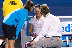 © Licensed to London News Pictures. 26/01/2013. Melbourne Park, Australia. Li Na laughs while getting medical attention after falling over during the Womens Final between Victoria Azarenka and Li Na of the Australian Open. Photo credit : Asanka Brendon Ratnayake/LNP