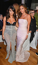 Left to right, KIM KARDASHIAN and NICOLE SCHERZINGER at the GQ Men Of The Year 2014 Awards in association with Hugo Boss held at The Royal Opera House, London on 2nd September 2014.