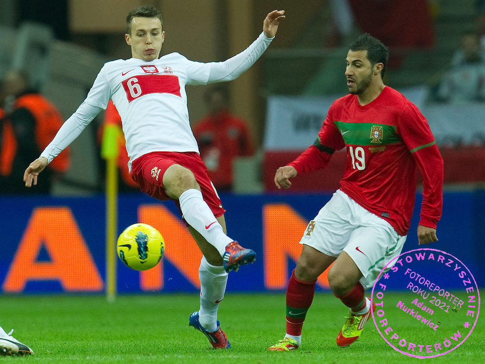 (L) Poland's midfielder Adam Matuszczyk fights for the ball with (R) Portugal's striker Ricardo Quaresma during friendly soccer match between Poland and Portugal at National Stadium in Warsaw, Poland..This is the inauguration of the new National Stadium..Poland, Warsaw, February 29, 2012..Picture also available in RAW (NEF) or TIFF format on special request...For editorial use only. Any commercial or promotional use requires permission...Photo by © Adam Nurkiewicz / Mediasport