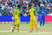 David Warner of Australia and Aaron Finch of Australia shake hands as they bring up the 50 with out loss for Australia during the ICC Cricket World Cup 2019 match between Afghanistan and Australia at the Bristol County Ground, Bristol, United Kingdom on 1 June 2019.