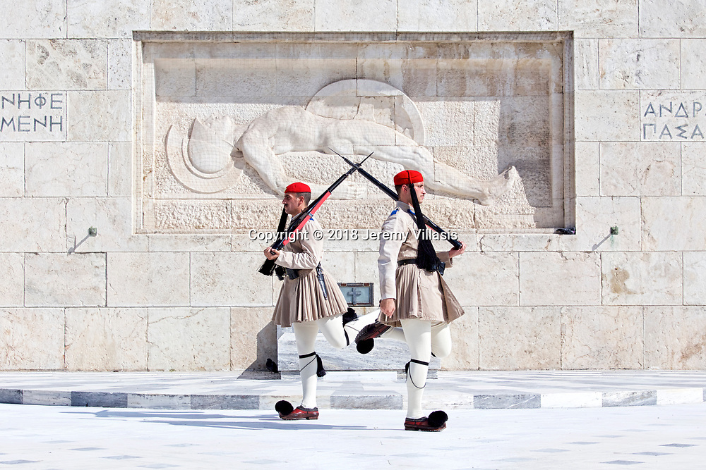 Evzones of the Presidential Guard march during the changing of the guard ceremony at the war memorial of the Tomb of the Unknown Soldier in the heart of modern Athens, Greece.