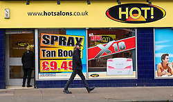 Tanning salon on Victoria Road in Govanhill district of Glasgow, Scotland,United Kingdom