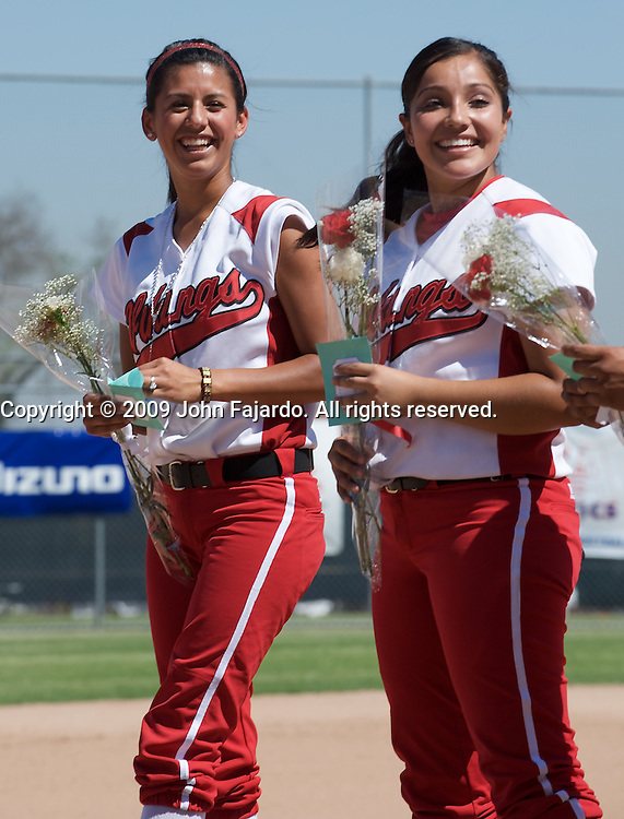 Jean Gallegos(l) and Roxana Benavides(r) smile during pregame festivities against Mt. SAC at the LAC softball field on Tuesday April 21, 2009.  The Vikings lose the final regular season home game to Mt. SAC 5-1.