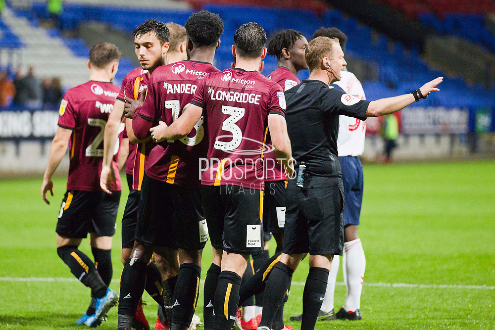 Bradford City team celebrate the win after winning on penalties  during the EFL Trophy match between Bolton Wanderers and Bradford City at the University of  Bolton Stadium, Bolton, England on 3 September 2019.