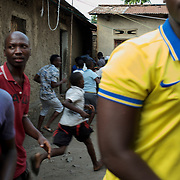 Locals react to gunfire shot by the Burundian National Police officers during a raid in Cibitoke neighbourhood, Bujumbura.