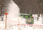 John Conley and Keith Rudolph hit the snowbank hard after sliding through the final turn of the fifteenth stage of the 2010 Sno-Drift road rally just ouside Atlanta, MI.