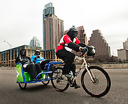 Three gorillas take a pedicab accross the 1st Street bridge during the 2012 Austin Gorilla Run on Sat., Jan. 21, 2012.  The 5K race benefits the Mountain Gorilla Conservation Fund.<br /> Ashley Landis