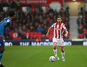 Stoke City midfielder Joe Allen (4) wins the ball during the EFL Sky Bet Championship match between Stoke City and Wigan Athletic at the Bet365 Stadium, Stoke-on-Trent, England on 23 November 2019.
