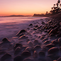 Santa Barbara Sunset. A usually sandy beach gets large boulders from strong ocean currents once a year.