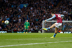Jack Grealish of Aston Villa (making his first Premier League start) strikes a free kick - Photo mandatory by-line: Rogan Thomson/JMP - 07966 386802 - 07/04/2015 - SPORT - FOOTBALL - Birmingham, England - Villa Park - Aston Villa v Queens Park Rangers - Barclays Premier League.