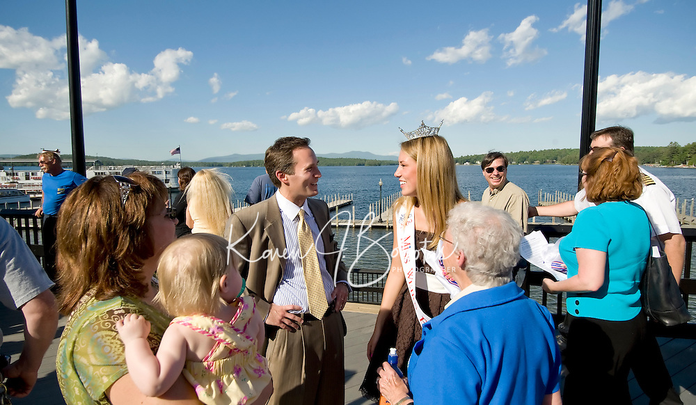 Mayor Michael Seymour and Miss Weirs Beach Megan Lyman enjoy the newly completed boardwalk after the reopening ceremony Thursday afternoon at Weirs Beach.  (Karen Bobotas/for the Laconia Daily Sun)
