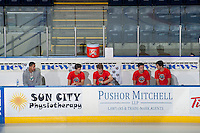 KELOWNA, CANADA - OCTOBER 25: Madison Bowey #4, Kris Schmidli #16, Rourke Chartier #14, Austin Glover #20 and Nick Merkley #10 of Kelowna Rockets sit on the bench pre-game against the Brandon Wheat Kings on October 25, 2014 at Prospera Place in Kelowna, British Columbia, Canada.  (Photo by Marissa Baecker/Shoot the Breeze)  *** Local Caption *** Madison Bowey; Kris Schmidli; Rourke Chartier; Austin Glover; Nick Merkley;