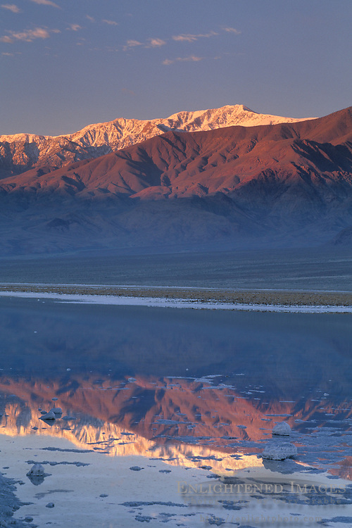 Sunrise light on Panamint Mountains over flooded salt pan, Devils Golf Course, Middle Basin, Death Valley, California