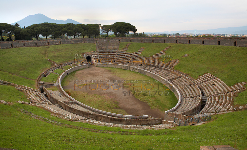 The ruins of the stadium at Pompeii, Italy with Mt. Vesuvius in the distance.