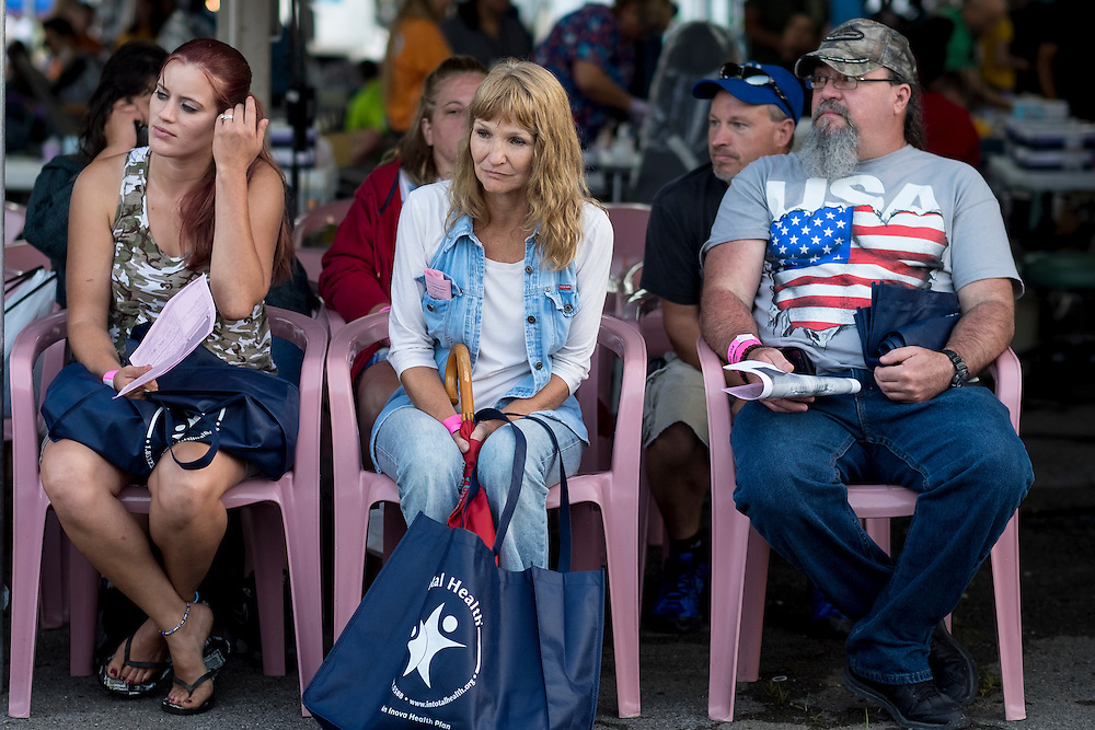 Patients wait to see a dentist at the 16th annual Remote Area Medical (RAM), clinic in Wise, Virginia, U.S., on Friday, July 17, 2015. RAM is a nonprofit that delivers free medical care to people living in rural areas. On RAM's first day it took in over 1,600 patients, setting an opening day record. By noon on Saturday, RAM had taken in another 1,000 patients. One woman's life may have been saved on Friday after women's health physicians determined she had a dangerous ectopic (tubal) pregnancy. She was taken to an area hospital for further care. In recent years, 2,500 to 3,000 people have sought care at this clinic at the fairgrounds. Photographer: Pete Marovich/Bloomberg