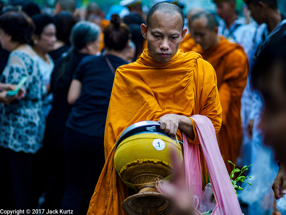 13 OCTOBER - BANGKOK, THAILAND: Buddhist monks participate in a mass merit making on the first anniversary of the death of Bhumibol Adulyadej, the Late King of Thailand. About 199 monks from 14 Buddhist temples in Bangkok participated in the mass merit making at Siriraj Hospital to mark the anniversary of the revered King's death. He will be cremated on 26 October 2017.  PHOTO BY JACK KURTZ