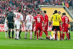 03.04.2010,  Rhein Energie Stadion, Koeln, GER, 1.FBL, FC Koeln vs 1. FC Nuernberg, 28. Spieltag, im Bild:  Andreas Wolf (Nuernberg #5) (R) liegt am Boden nach einem eventuellen Tritt von Youssef Mohamad (Koeln #3). Sofort bildet sich eine Spielertraube  EXPA Pictures © 2011, PhotoCredit: EXPA/ nph/  Mueller       ****** out of GER / SWE / CRO  / BEL ******