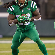 Nov 12, 2015; East Rutherford, NJ, USA;  New York Jets running back Chris Ivory (33) runs the ball in the first half at MetLife Stadium. The Bills defeated the Jets 22-17 Mandatory Credit: William Hauser-USA TODAY Sports