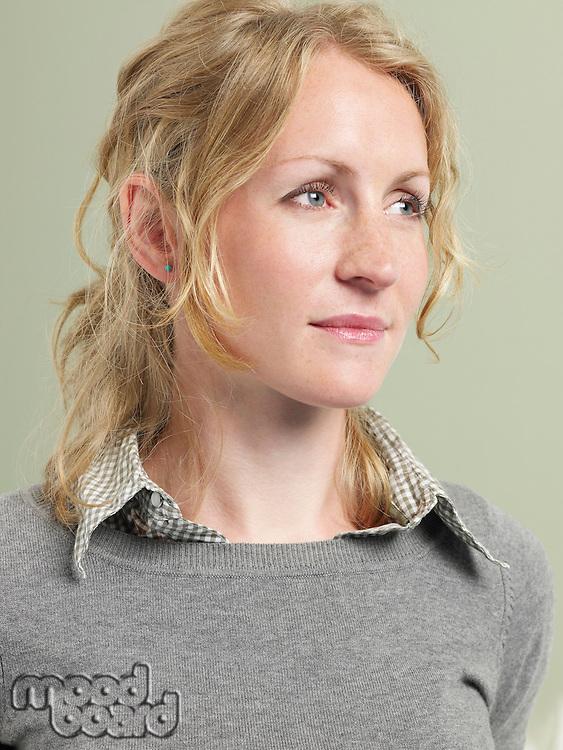 Mid-adult woman looking away
