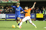 AFC Wimbledon striker Lyle Taylor (33) taking on Southend United defender John White (48) during the EFL Sky Bet League 1 match between AFC Wimbledon and Southend United at the Cherry Red Records Stadium, Kingston, England on 1 January 2018. Photo by Matthew Redman.
