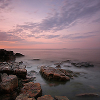 Sunrise seacoast photography fine art prints are available as museum quality photography prints, canvas prints, acrylic prints or metal prints. Prints may be framed and matted to the individual liking and room decor needs:<br /> <br /> http://juergen-roth.artistwebsites.com/featured/sunrise-at-seawall-in-southwest-harbor-juergen-roth.html<br /> <br /> Sunrise seacoast photography image of the rocky coastline and the Atlantic Ocean in Maine Acadia National Park. Seawall is a naturally formed granite and rock seawall located on the southwestern side of Mount Desert Island in Southwest Harbor. I stayed nearby on my recent trip to Acadia and was able to head out early enough to capture the first light at this iconic Acadia NP location.  <br /> <br /> Acadia NP is a National Park located in the U.S. state of Maine. It reserves much of Mount Desert Island, and associated smaller islands, off the Atlantic coast. Originally created as Lafayette National Park in 1919, the first National Park East of the Mississippi, it was renamed Acadia in 1929. The park is one of the most visited wildlife areas in the United States and a paradise for every photographer and outdoor enthusiast. The park loop road provides easy access to many of the iconic photography subjects, such as Monument Cove, The Beehive, Sand Beach, Jordan Pond and the Bubbles, Bubble Pond, Otter Cliff to name only a few. The carriage roads and hiking trails provide further access to more remote locations where the park continues to inspire and unfolds its full magic. It is a heaven for macro, seascape, and landscape photography that makes for great wall art decoration. Especially sunrise and the light of the golden hours paint the sky in beautiful blue and orange and brings out the beauty of the pink granite rocks.<br /> <br /> Good light and happy photo making! <br /> <br /> My best, <br /> <br /> Juergen <br /> Art Prints: www.RothGalleries.com <br /> Image Licensing: www.ExploringTheLight.com <br /> Photo Blog: h