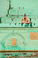 Holy man praying at one of northern, and quieter, ghats.