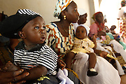 Mothers wait to have their children vaccinated at the Kita reference health center in the town of Kita, Mali on Monday August 30, 2010..