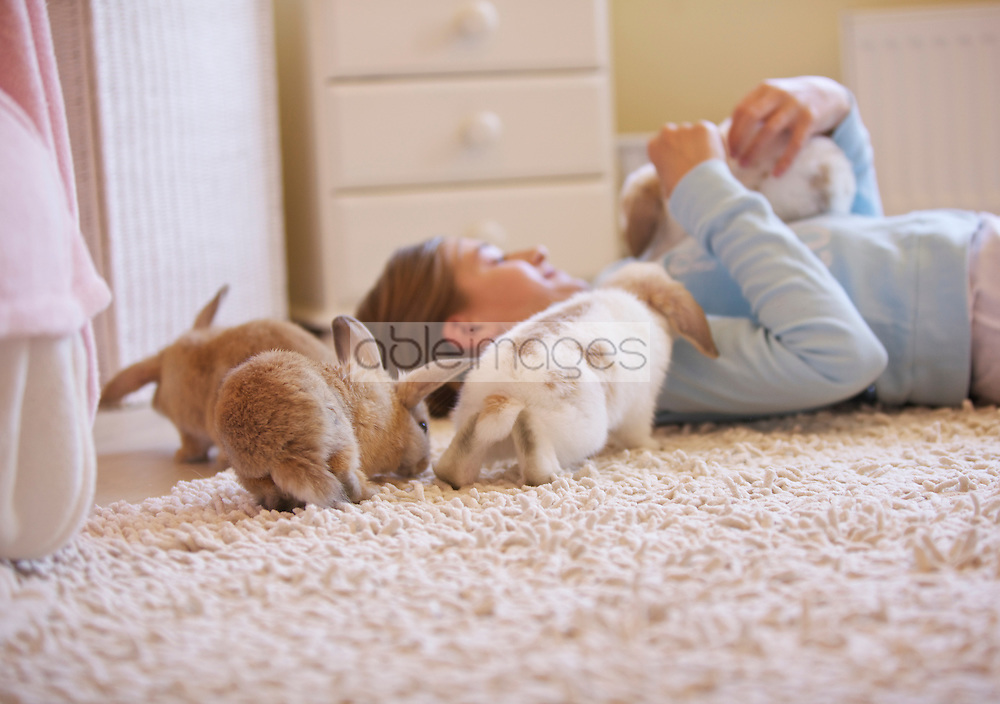 Girl Playing with Rabbits