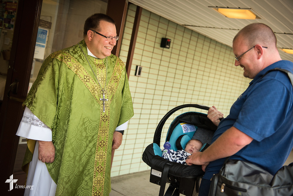 The Rev. Kent Tibben greets worshippers to Trinity Lutheran Church on Wednesday, July 15, 2015, in Danville, Ill. LCMS Communications/Erik M. Lunsford