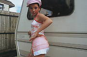 A Doherty sister wearing a pink cap posing by a caravan, Winterbourne Travellers site, Bristol, October 2002