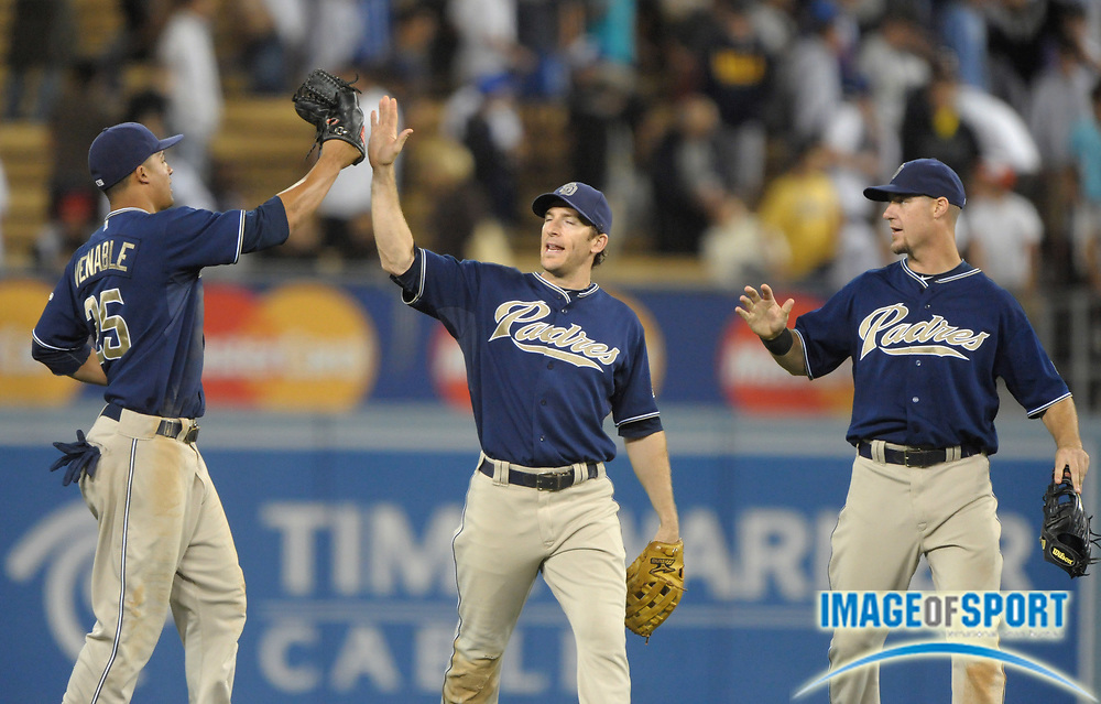 Aug 2, 2010; Los Angeles, CA, USA; San Diego Padres outfielders (from left) Will Venable (25), Chris Denorfia (13) and Ryan Ludwick (47) celebrate after the Padres' 10-5 victory over the Los Angeles Dodgers at Dodger Stadium.  Photo by Image of Sport