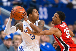Kentucky guard Tyler Ulis, left, looks for an open teammate with pressure from Georgia guard J.J. Frazier in the first half.<br /> <br /> The University of Kentucky hosted the University of Georgia, Tuesday, Feb. 09, 2016 at Rupp Arena in Lexington .
