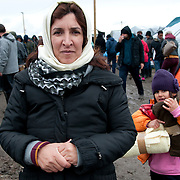 France. Refugees. Calais. So-called Jungle camp. Nais and her daughter Karla, from Iraq, with the blanket they have been given