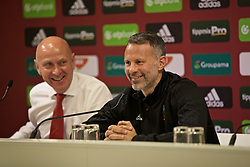 BUDAPEST, HUNGARY - Monday, June 10, 2019: Wales' manager Ryan Giggs (R) and head of public affairs Ian Gwyn Hughes during a press conference ahead of the UEFA Euro 2020 Qualifying Group E match between Hungary and Wales at the Ferencváros Stadion. (Pic by David Rawcliffe/Propaganda)