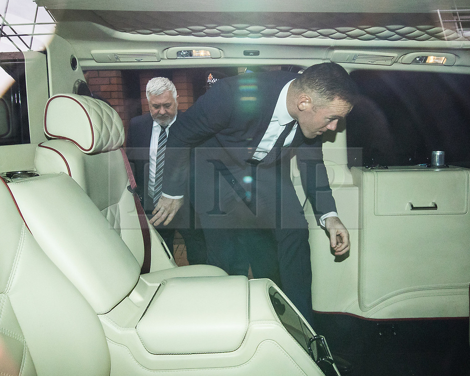 © Licensed to London News Pictures . 18/09/2017 . Stockport , UK . Everton footballer WAYNE ROONEY gets in to his car as he leaves Stockport Magistrates Court where he faced a drink-driving charge . The former England and Manchester United captain was arrested by police whilst driving in Wilmslow in Cheshire during the early hours of 1st September . Photo credit: Joel Goodman/LNP