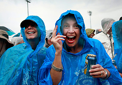 28 April 2013. New Orleans, Louisiana,  USA. .Faces in the crowd. The latest rain fashions at a rain soaked New Orleans Jazz and Heritage Festival. .Photo; Charlie Varley.