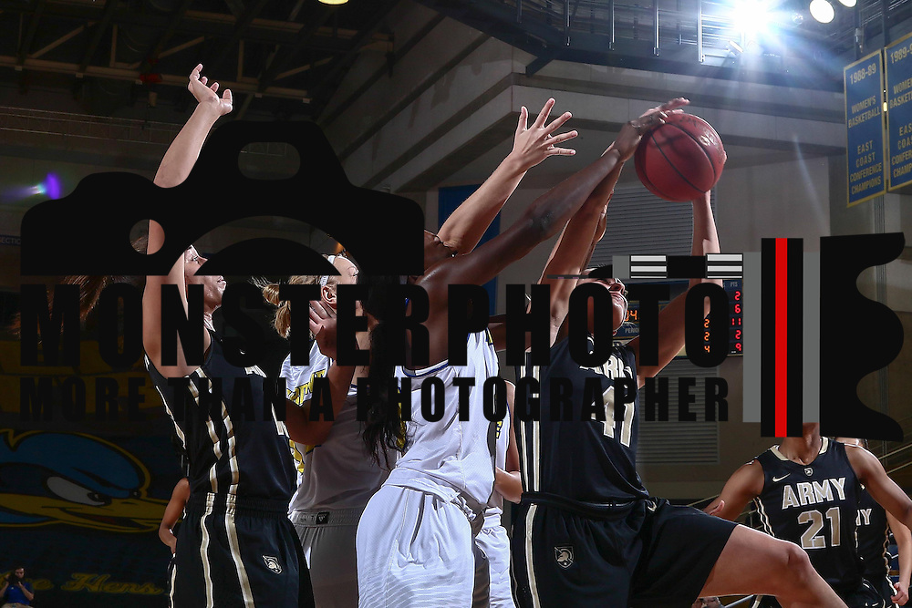 Army West Point Forward Madison Hovren (41) drives to the basket as Delaware Forward Nicole Enabosi (33) defends during a regular-season non conference game between Delaware and Army West Point Sunday, Dec. 11, 2016, at the Bob Carpenter Center in Newark Delaware.