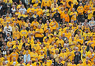 October 6 2013: Iowa Hawkeyes fans stand during the National Anthem before the start of the NCAA football game between the Michigan State Spartans and the Iowa Hawkeyes at Kinnick Stadium in Iowa City, Iowa on October 6, 2013. Michigan State defeated Iowa 26-14.