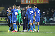 AFC Wimbledon interim manager Simon Bassey shaking hands with AFC Wimbledon goalkeeper Joe McDonnell (24) during the EFL Sky Bet League 1 match between AFC Wimbledon and Southend United at the Cherry Red Records Stadium, Kingston, England on 24 November 2018.