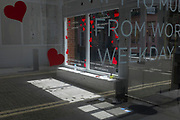 With a further 89 UK covid victims in the last 24hrs, bringing the total victims to 43,995 during the Coronavirus pandemic, businesses are starting to re-open according to government to the easing of restrictions but a small business with hearts on its windows remains closed, on 2nd July 2020, in London, England.