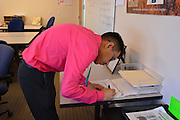 Rodolfo signs out before going to his assignment.