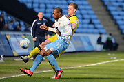 Bristol Rovers defender James Clarke (15) makes a tackle on Coventry City midfielder Kyel Reid (11) 0-0 during the EFL Sky Bet League 1 match between Coventry City and Bristol Rovers at the Ricoh Arena, Coventry, England on 25 March 2017. Photo by Alan Franklin.
