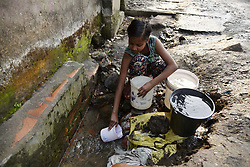 March 22, 2019 - Guwahati, India - A girl collecting water from a leakage pipe near a drain in Guwahati, Assam, India on on 22 March 2019. World Water Day is held annually on March 22, as a means of focusing attention on the importance of freshwater. 'Leaving no one behind' is the theme of World Water Day 2019. (Credit Image: © David Talukdar/NurPhoto via ZUMA Press)