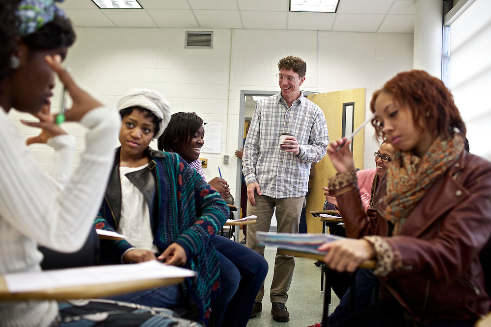 Greg Wahl, right, associate professor at Montgomery College, works with students including Latesha Casey, center, in his Basic Writing II class, as students formed groups to begin work on their final project for class. If students pass this class, it allows them to progress to the college level english program. Otherwise students will face the decision to take the remedial class again or drop out.
