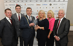 Caroline McLoughlin from Parkinson&rsquo;s Association of Ireland - Mayo Branch accecpting a Westport Lions club Clew Bay People of the Year Award with Patrick Daly, Cathal Tayna and Sean McLoughlin.<br />